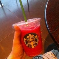 Photo taken at Starbucks by Laura V. on 12/11/2012