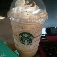 Photo taken at Starbucks by Fernanda A. on 12/26/2014