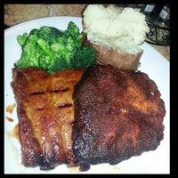Photo taken at Smokey Bones Bar & Fire Grill by Terrell B. on 3/4/2013