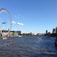Photo taken at Hungerford & Golden Jubilee Bridges by Lorenzo C. on 7/28/2013