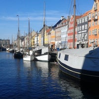 Photo taken at Nyhavnsbroen by Irina B. on 3/8/2015