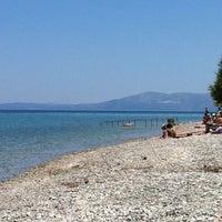 Photo taken at Vlastos beach by Stelios K. on 6/4/2012