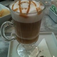 Photo taken at Seven Wonders Café by Rana G. on 12/29/2011