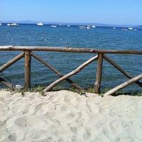 Photo taken at Beach Punta Ala by Eva P. on 8/20/2011