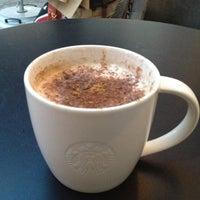 Photo taken at Starbucks by Ju J. on 5/17/2012