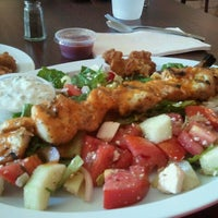 Photo taken at Mikonos Grill by Eileen O. on 7/30/2011