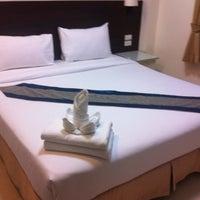 Photo taken at @ White Patong Hotel by Wayne T. on 1/12/2012