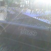 Photo taken at Tacos Peralta by Erik H. on 12/28/2011