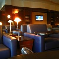 Photo taken at Admirals Club by Geoffrey E. on 10/25/2011