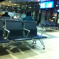 Photo taken at QAIA - Gate 11 by Aisha F. on 1/11/2012