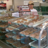 Photo taken at Krispy Kreme Doughnuts by Chris on 9/18/2011