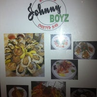 Photo taken at Johnny Boyz Seafood & Oyster Bar by Meg Y. on 3/12/2011