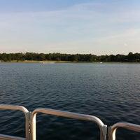 Photo taken at Swan Lake by Claudia G. on 7/19/2011
