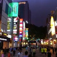 Photo taken at 北京路步行街 Beijing Road Pedestrian Street by Paulinho B. on 4/16/2012