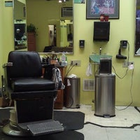 Photo taken at Sharon Square Barber Shop by Mark N. on 1/5/2012