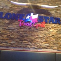 Photo taken at Lone Star Texas Grill by Jonathan M. on 8/25/2012