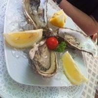 Photo taken at Fish'ka by Maria M. on 7/19/2012