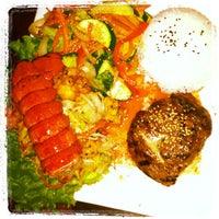 Photo taken at Banbu Sushi Bar & Grill by Tony S. on 10/28/2011