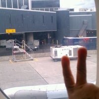 Photo taken at Gate F2 by Neecie on 10/19/2011