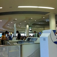 Photo taken at Gate 33 by tae f. on 6/3/2012