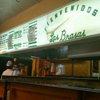 Photo taken at Las Brasas by Moises R. on 12/30/2011