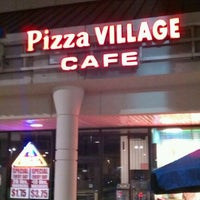 Photo taken at Pizza Village Cafe by Tiago R. on 9/3/2011