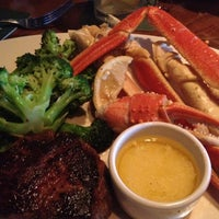 Photo taken at Outback Steakhouse by Nik A. on 7/8/2012