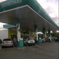Photo taken at Petronas by Lynn M. on 12/23/2011