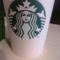 Photo taken at Starbucks by Joellen V. on 3/15/2011