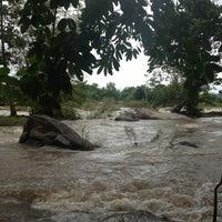Photo taken at แก่งเกาะใหญ่ @ธารน้ำแม่เรวา by Jeerapha J. on 9/9/2012