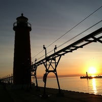 Photo taken at Grand Haven State Park by Justin Y. on 6/27/2012
