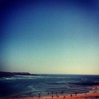 Photo taken at Praia de Vila Nova de Milfontes by Emanuele F. on 8/12/2012