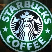 Photo taken at Starbucks by Penporn N. on 2/10/2012
