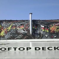 Photo taken at Reggie's Trainwreck Rooftop Deck by Russell H. on 3/19/2012