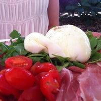 Photo taken at Quattro Gastronomia Italiana by Amanda P. on 2/24/2012