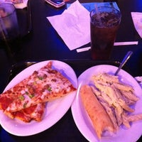 Photo taken at John's Incredible Pizza Company by Rick G. on 3/4/2012