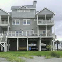 Photo taken at The Waymire Beach House by Maurice P. on 2/17/2012