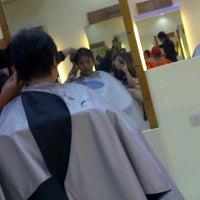 Photo taken at Ricky Reyes Hair Salon by marifa b. on 4/21/2012