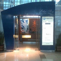 Photo taken at BLUE SKY Executive Lounge by Andi N. on 7/11/2012