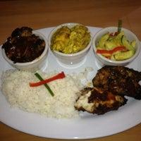 Photo taken at Jamaica Gates Caribbean Restaurant by Juliet S. on 2/25/2012
