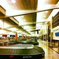 Photo taken at South Baggage Claim by Chris K. on 3/27/2012