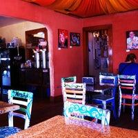 Photo taken at Dandelion Communitea Café by Erika W. on 5/8/2012