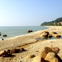 Photo taken at Pantai Teluk Cempedak (Beach) by Jing Shan C. on 8/20/2012