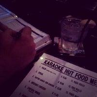 Photo taken at Karaoke Hut Sports Bar & Grill by Malia Y. on 7/7/2012