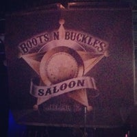 Photo taken at Boots N Buckles Saloon by Brian S. on 3/9/2013