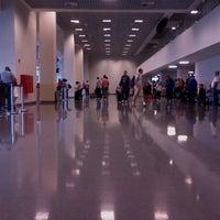 Photo taken at Terminal 1 (TPS1) by Julianna K. on 11/25/2012