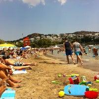 Photo taken at Vouliagmeni Beach by 👑Efi on 7/14/2013