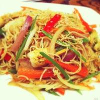 Photo taken at Wild Ginger Pan-Asian Vegan Cafe by Kate T. on 12/24/2012