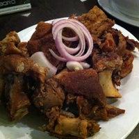 Photo taken at Giligan's by Desi R. on 12/13/2012