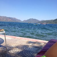 Photo taken at Marmaris Park Beach by Олеся on 8/7/2013
